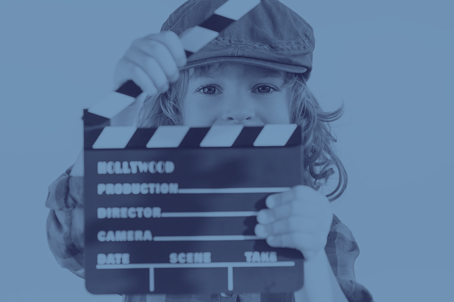 Child holding clapperboard